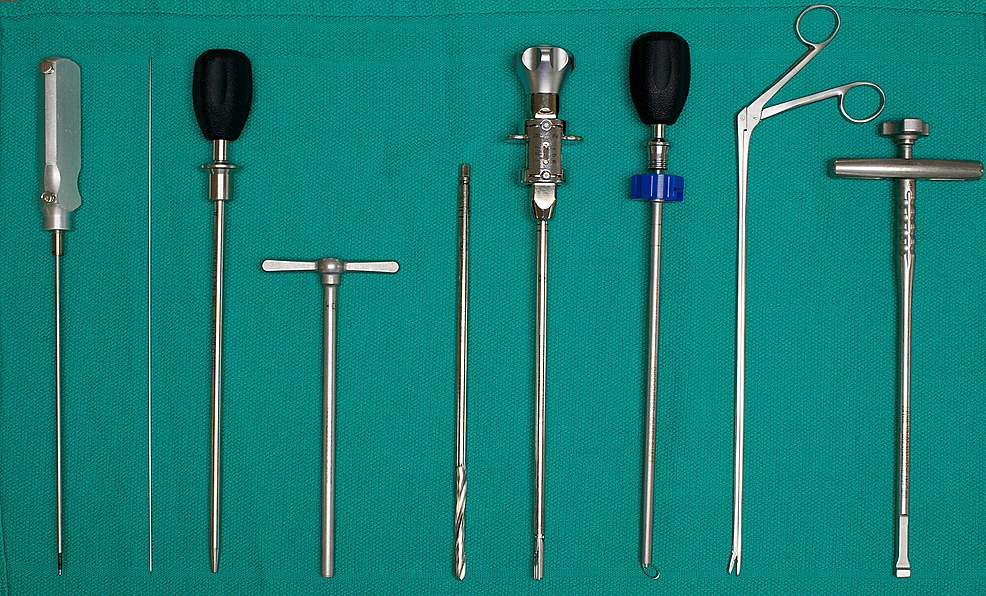 Instrumentation-used-for-MIS-DLIF-(left-to-right):-Probe,-K-wire,-dilator,-working-tube,-disk-drill,-rotating-curette,-ring-curette,-rongeur,-cage-insertion-device