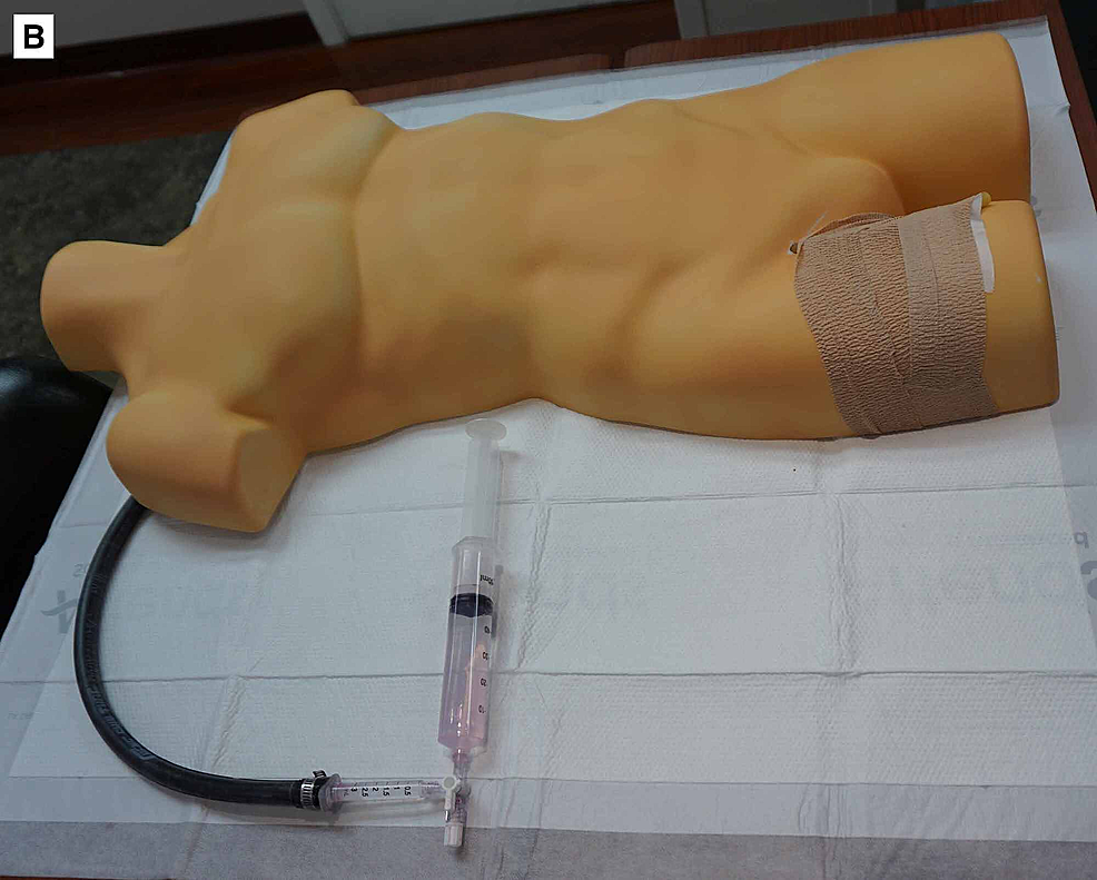 Completed-REBOA-insertion-trainer.-The-rubber-tubing-(used-to-simulate-the-femoral-artery)-is-covered-and-secured-to-the-torso-using-self-adherent-wrap-to-simulate-skin.