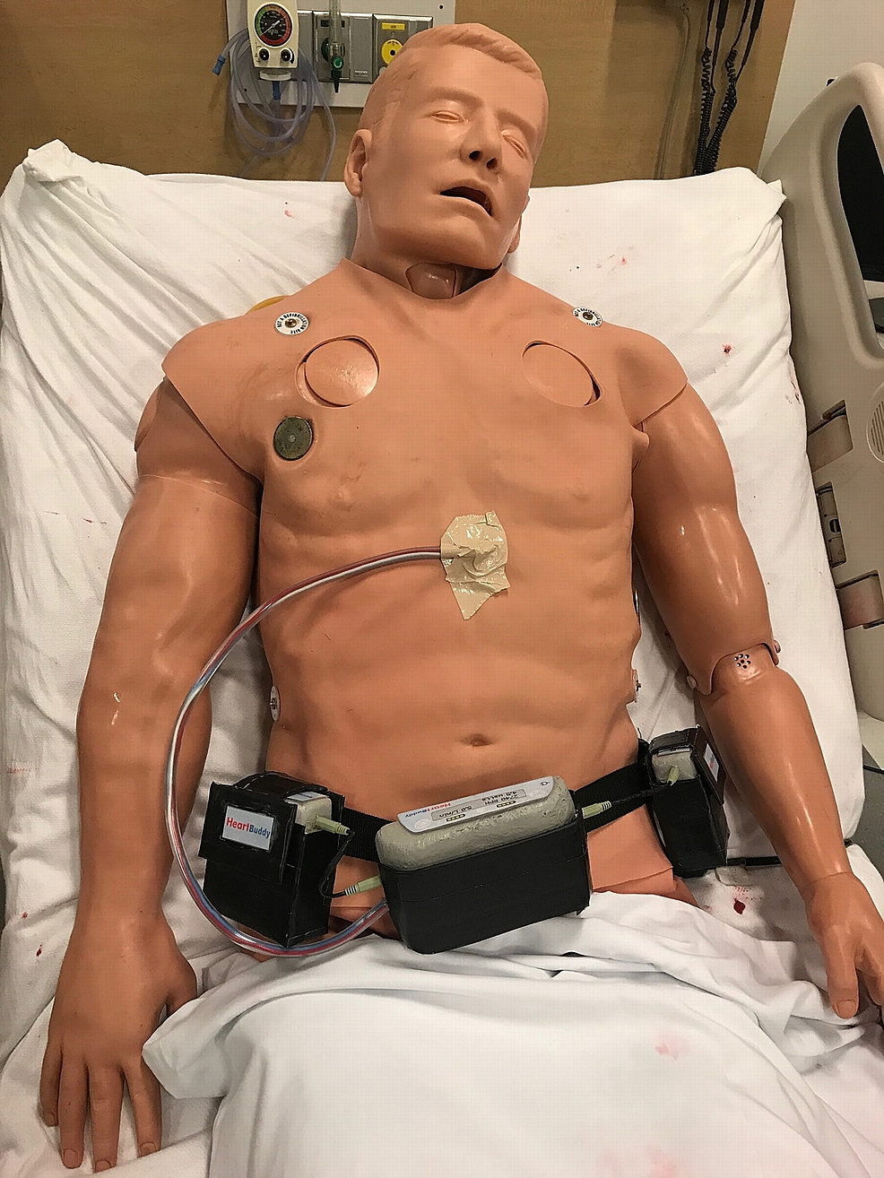 Simulaids-Stat-Manikin-with-Deluxe-Airway-Management-Head-Simulator-wearing-simulated-left-ventricular-assist-device-(LVAD)