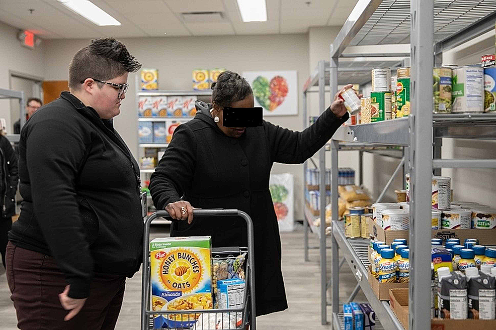 A-patient-getting-food-and-other-supplies-at-the-SIU-Center-for-Family-Medicine-(FQHC)-food-pantry