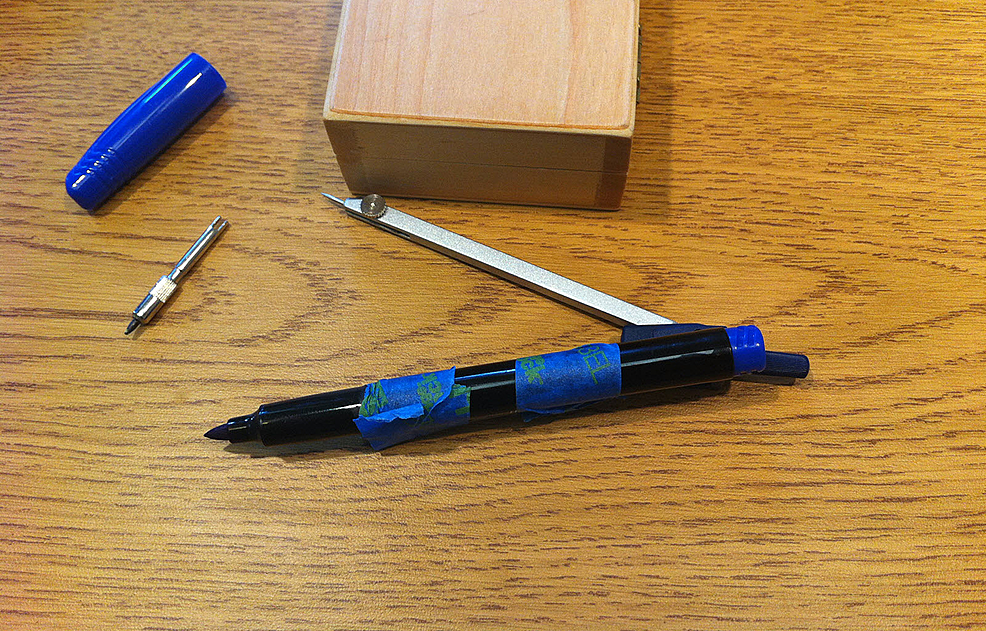 Felt-tipped-pen-secured-to-draftsman's-compass