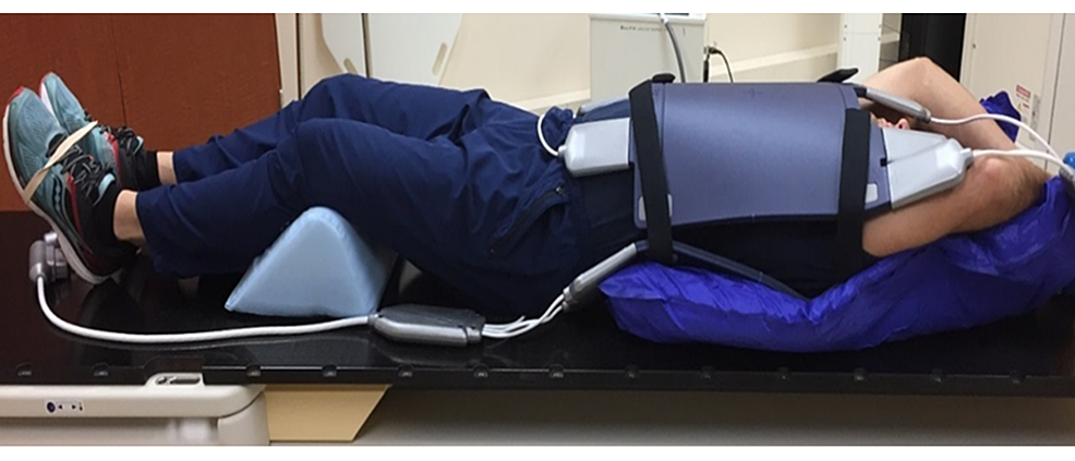 Schematic-of-patient-setup-for-MR-simulation.-Immobilization-devices-consist-of-anterior-and-posterior-torso-MRI-receive-coils-embedded-in-a-medium-sized-vacuum-cushion.