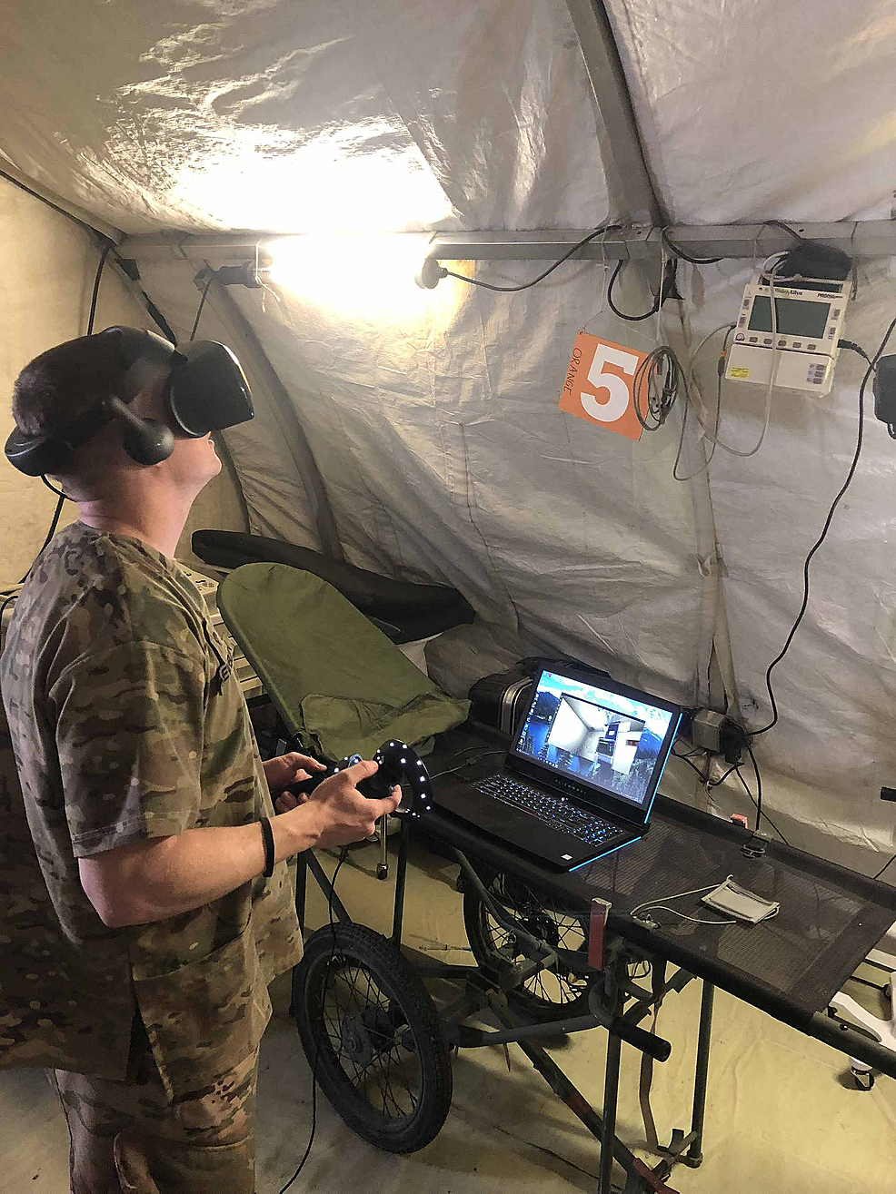 Medic-completing-an-immersive-virtual-reality-trauma-simulation