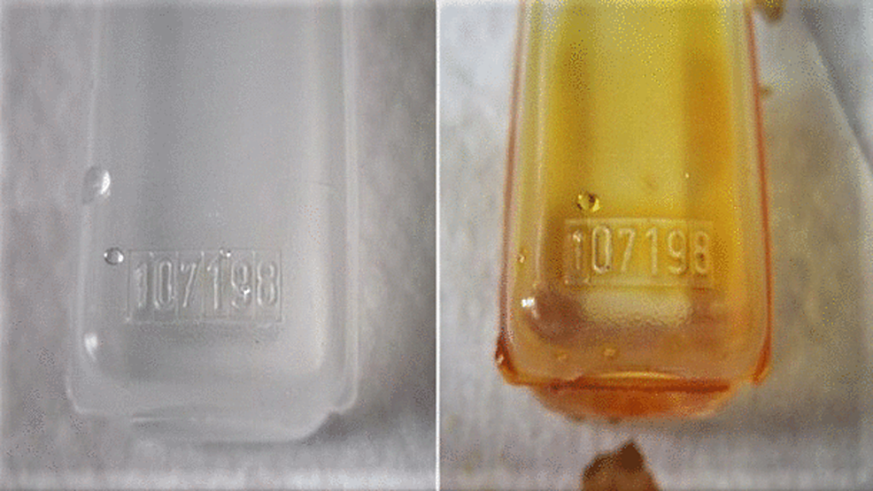 Photograph-showing-an-ampoule-before-and-after-Betadine-dip